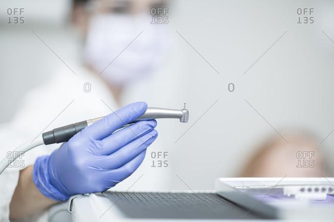 Female dentist holding amalgam carrier