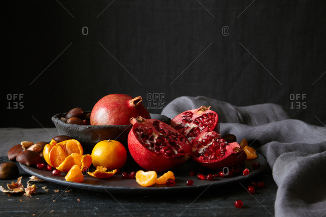 Still life of a plate of fruit and nuts