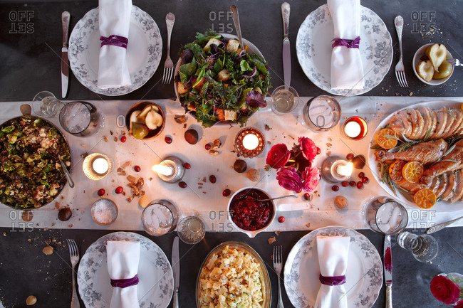 Overhead view of a dining table set for Thanksgiving dinner