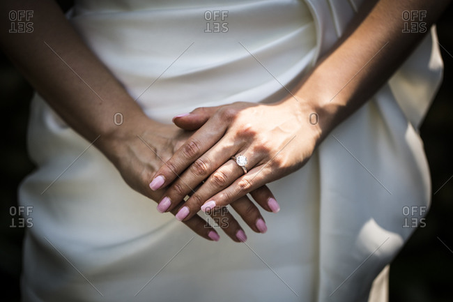 A young Asian bride shows off her wedding ring