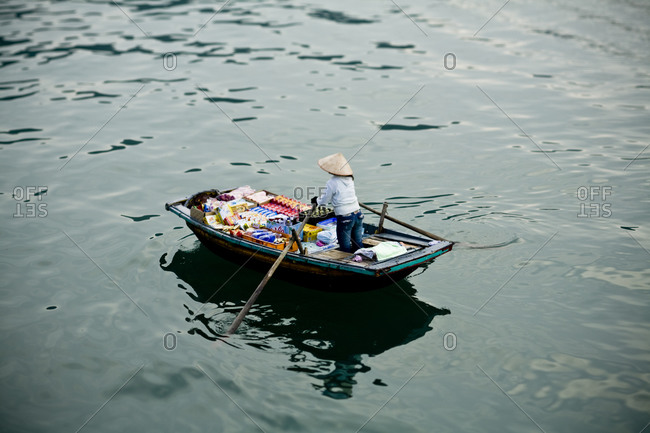 A boat travels along the waters of Halong Bay