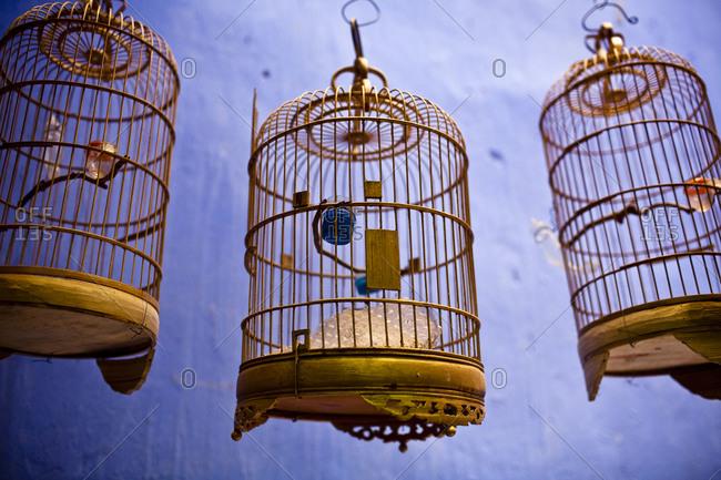Classic wooden bird cages hang in Hanoi, Vietnam