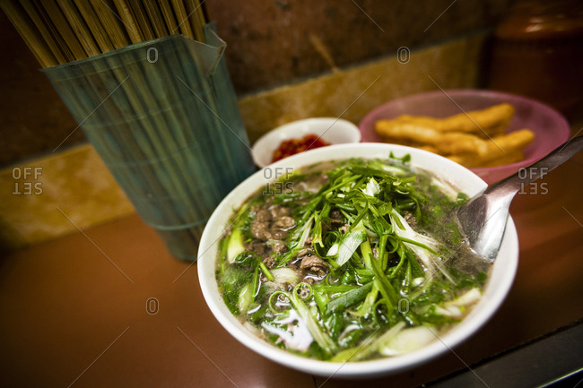 Pho noodle dish served in restaurant in Vietnamese