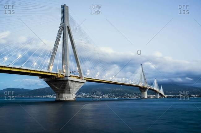 Cable stayed bridge over water leading to a city on the other side