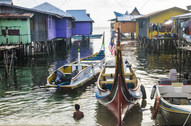 January 31, 2015: Boats and stilt houses of Mabul Island, Borneo, Malaysia
