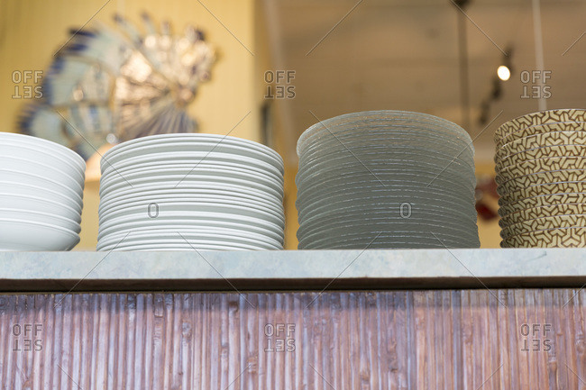 Stacks of plates on a counter