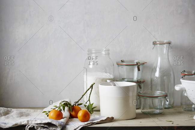 Mandarin oranges next to jars