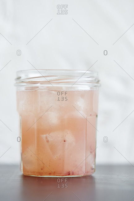 A pink cocktail in a jar