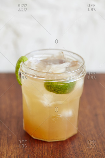 A peach cocktail with a lime twist