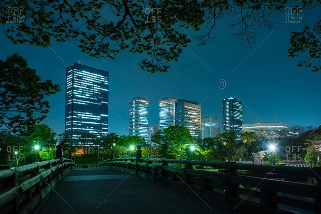 A bridge leading away from Osaka Castle Park at night