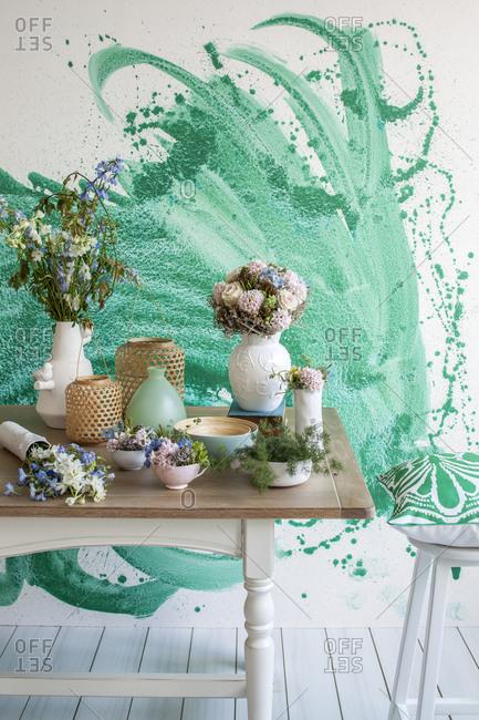 Flower arrangements spread across a table