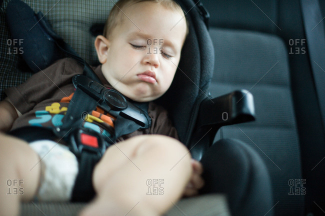 Little boy sleeping in a car