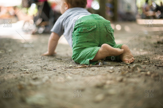 Little boy crawling on the ground