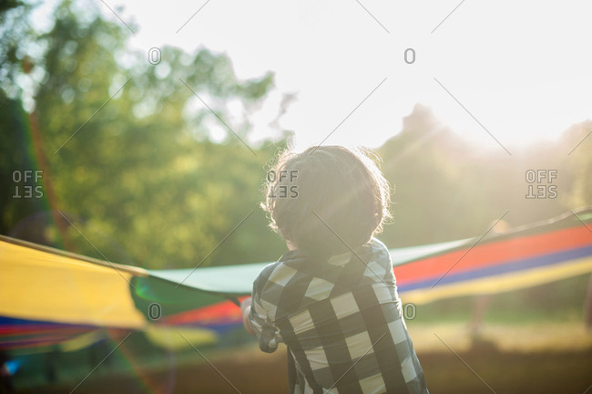 Little boy stretching out a parachute