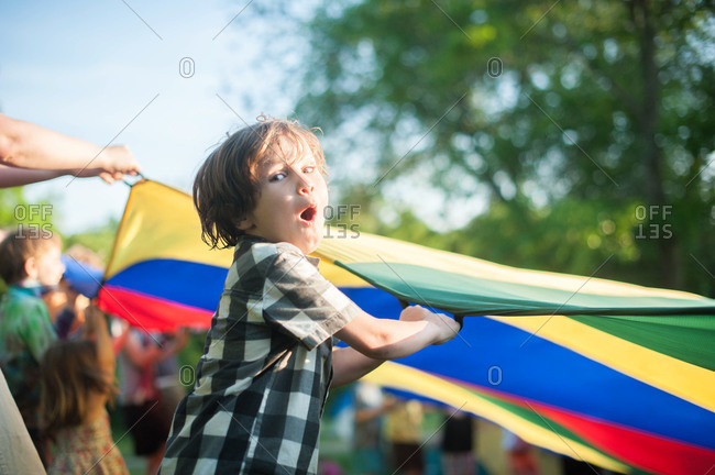 Boy playing a parachute game