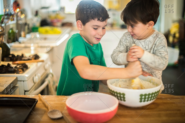 Boys baking together in the kitchen