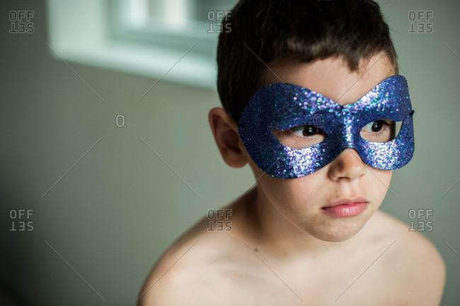 Portrait of boy wearing a mask