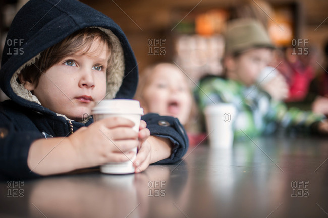 Boy holding a cup of warm drink