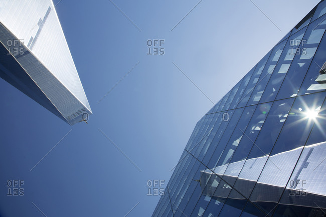One World Trade Center reflected in a the glass facade of the 9/11 Memorial Museum, New York City
