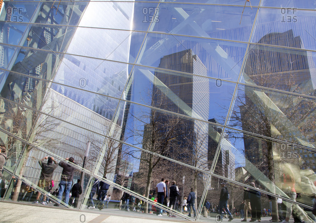 Reflections in a the glass facade of the 9/11 Memorial Museum, New York City