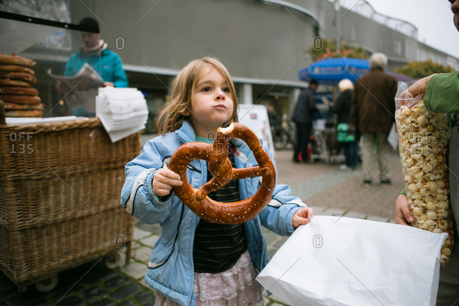 Girl with an enormous pretzel from a street vendor