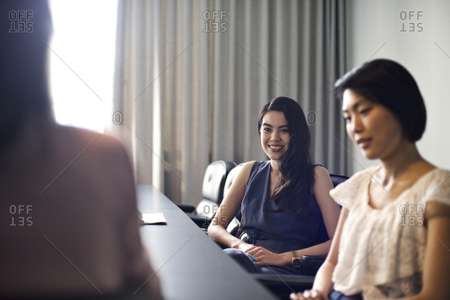 Women meet in a conference room