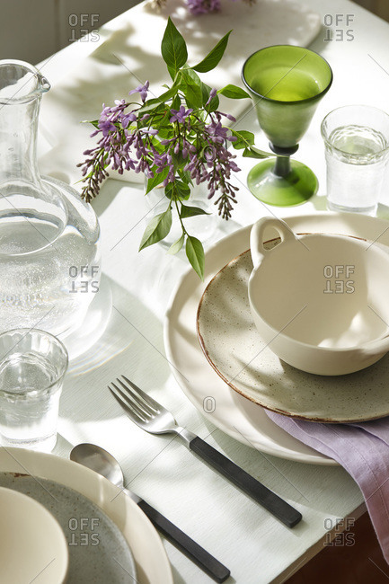 A table setting with purple flowers
