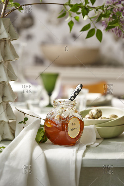 Fig preserves on a rustic dining room table