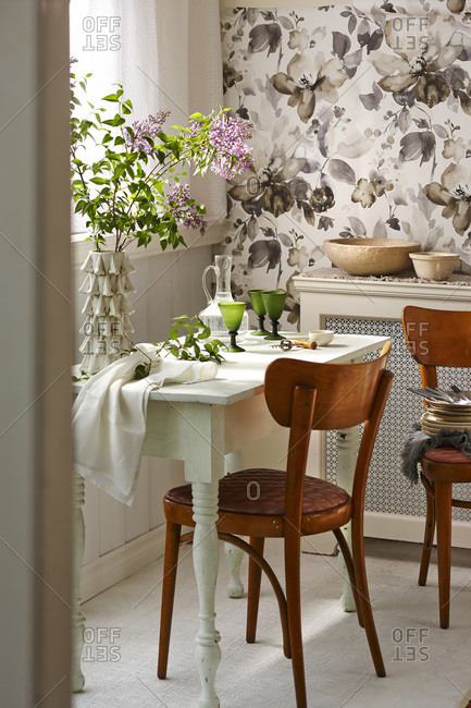 A rustic dining room table with one chair