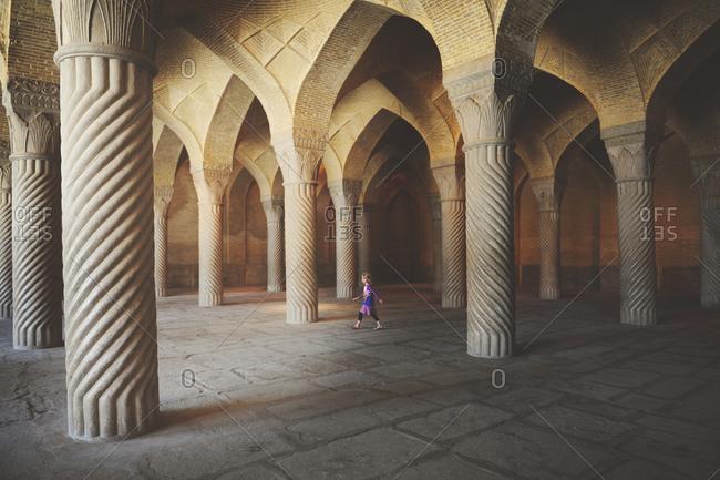 Shiraz, Iran - October 18, 2014: Girl walking in the prayer hall of Vakil Mosque