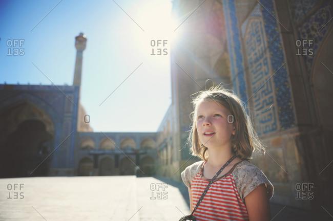 Isfahan, Iran - October 22, 2014: Girl at the Jameh Mosque of Isfahan