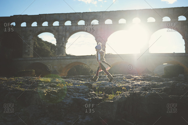 Young girl walking by the The Pont du Gard in France