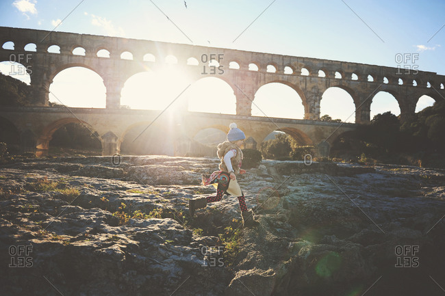 Young girl walking along the The Pont du Gard in France