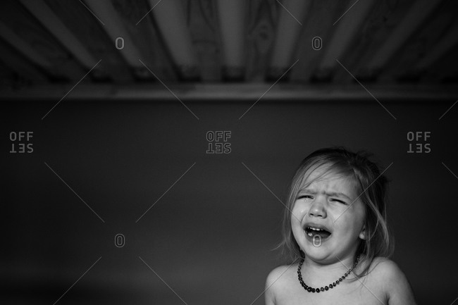 Unhappy child's crying face