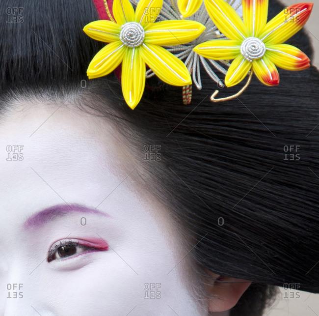 Kyoto, Japan - April 8, 2012: Close-up of a geisha's eye and hair ornament