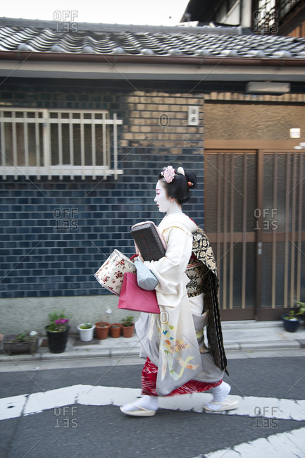 Kyoto, Japan - April 8, 2012: A maiko carries her belongings on the streets of Kyoto