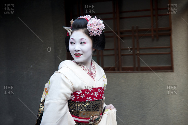 Kyoto, Japan - April 8, 2012: Beautiful geisha in her elaborate costume