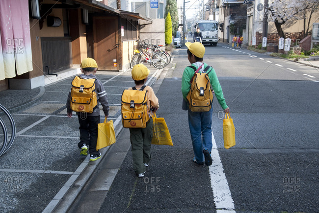 Kyoto, Japan - April 8, 2012: Boys in yellow caps walk to school in Kyoto
