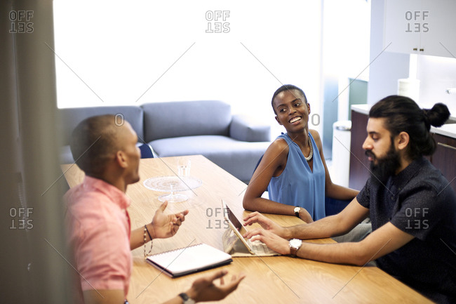 Coworkers talk in the office break room