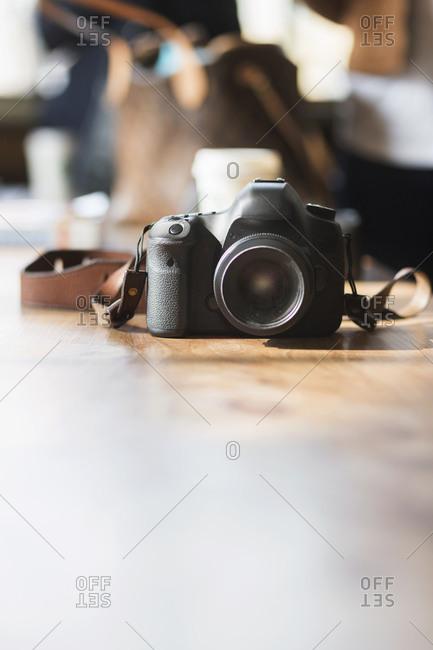 A digital camera on a long table