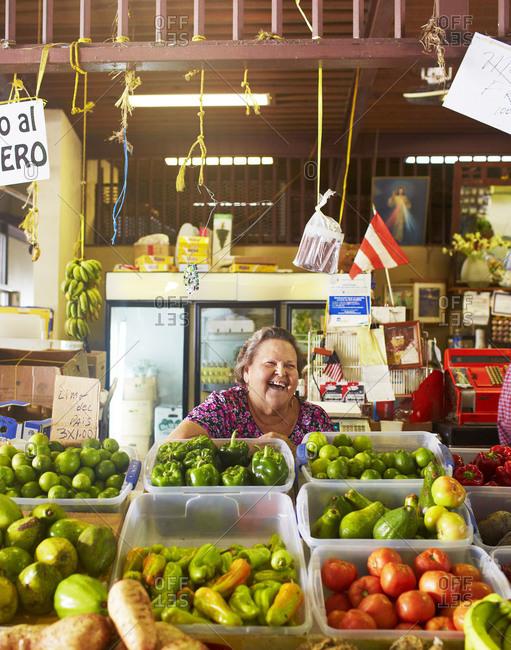 Condado Beach, Puerto Rico - October 28, 2014: A woman at the market laughs