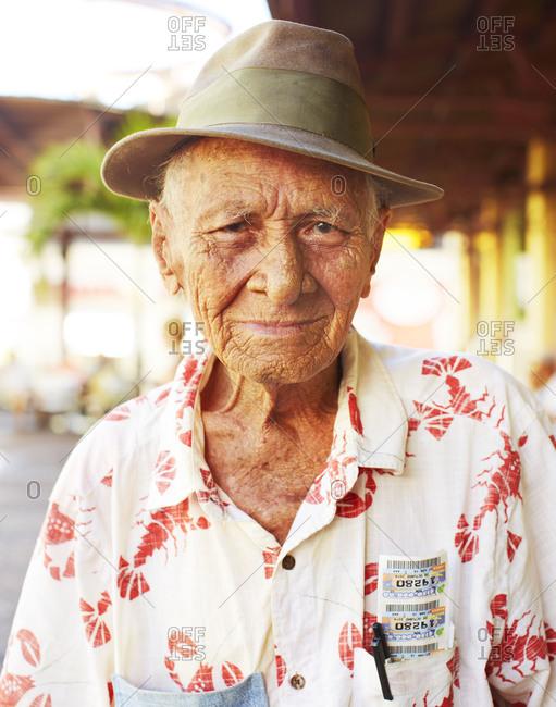 Condado Beach, Puerto Rico - October 28, 2014: A mature Puerto Rican man in a fedora