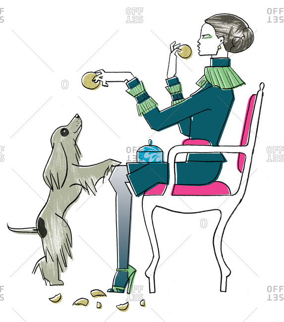 Well dressed woman feeding a dog