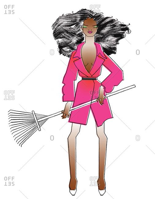 Sexy woman holding a rake