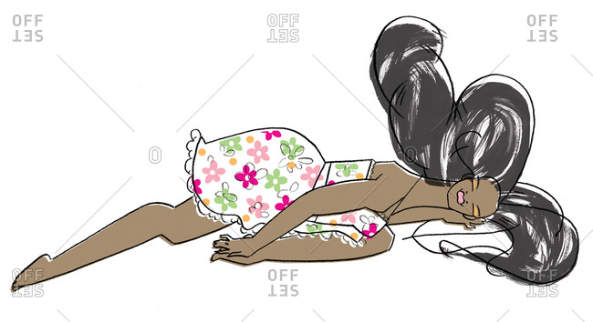 Woman lying on ground in floral dress