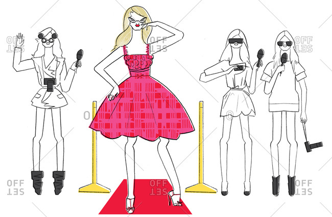 Woman on red carpet with paparazzi