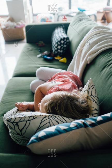 Girl laying on couch taking a nap