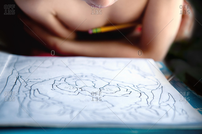 Child working on a dot-to-dot workbook