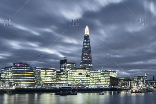 London, England, United Kingdom - July 29, 2014: The Thames in Southwark with City Hall, the Shard and HMS Belfast, London, England, United Kingdom