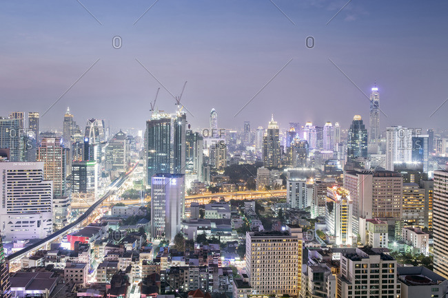 Bangkok, Thailand - January 23, 2015: City skyline looking along the BTS Skytrain, Sukhumvit Road and Phloen Chit, with the Baiyoke Tower II to the right of frame, Bangkok, Thailand, Southeast Asia